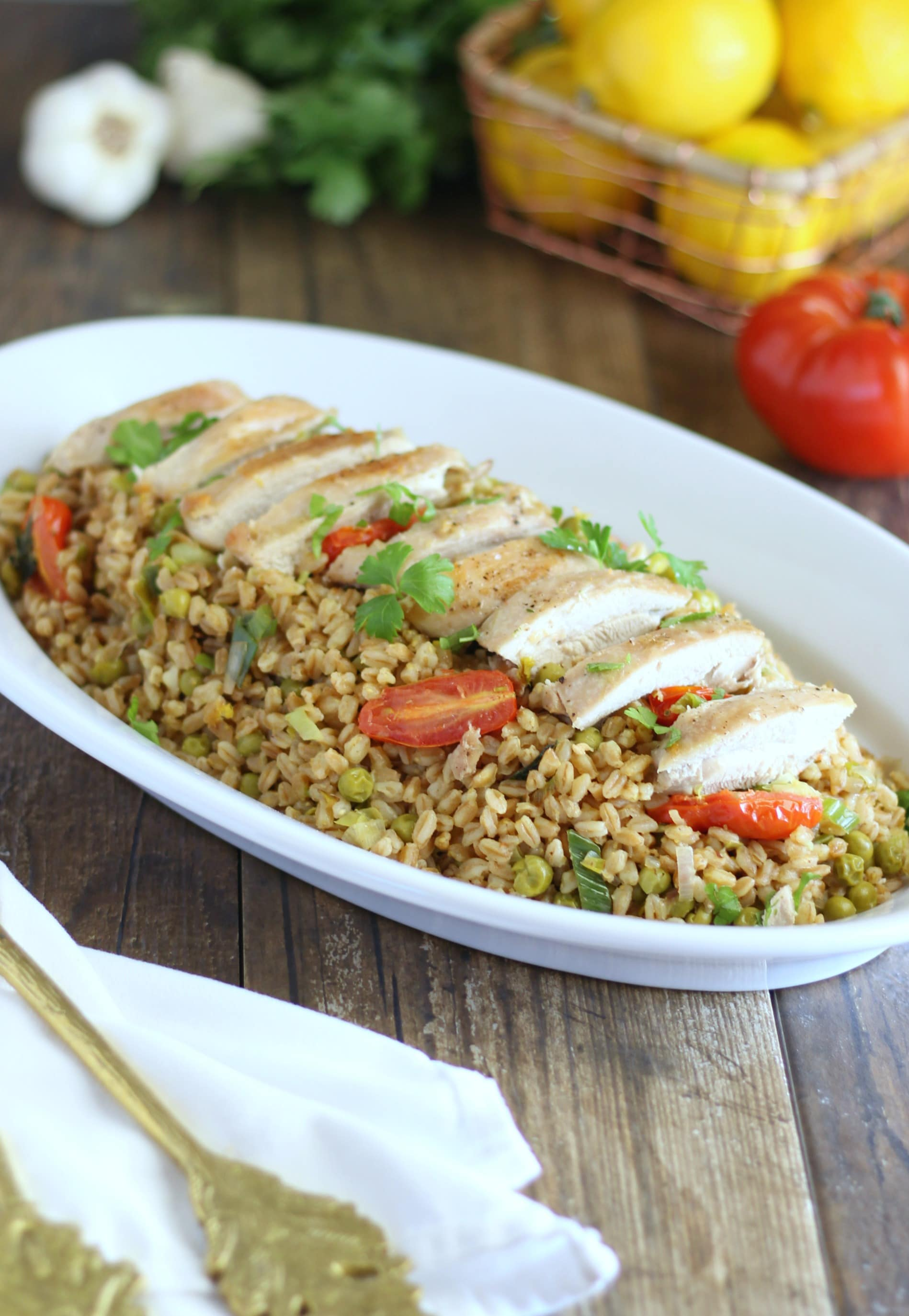 This roasted chicken with farro and fresh spring veggies is a delightful and complete dinner recipe that you can easily prepare for a week night meal.