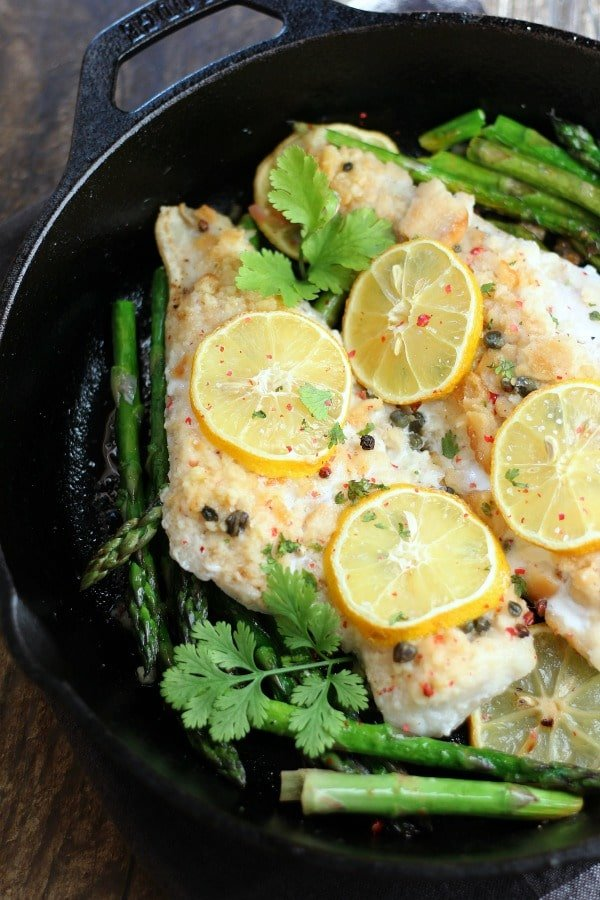 This Baked Cod recipe is incredibly easy to make and only takes 25-minutes. A truly perfect meal for a busy week night! gardeinthekitchen.com