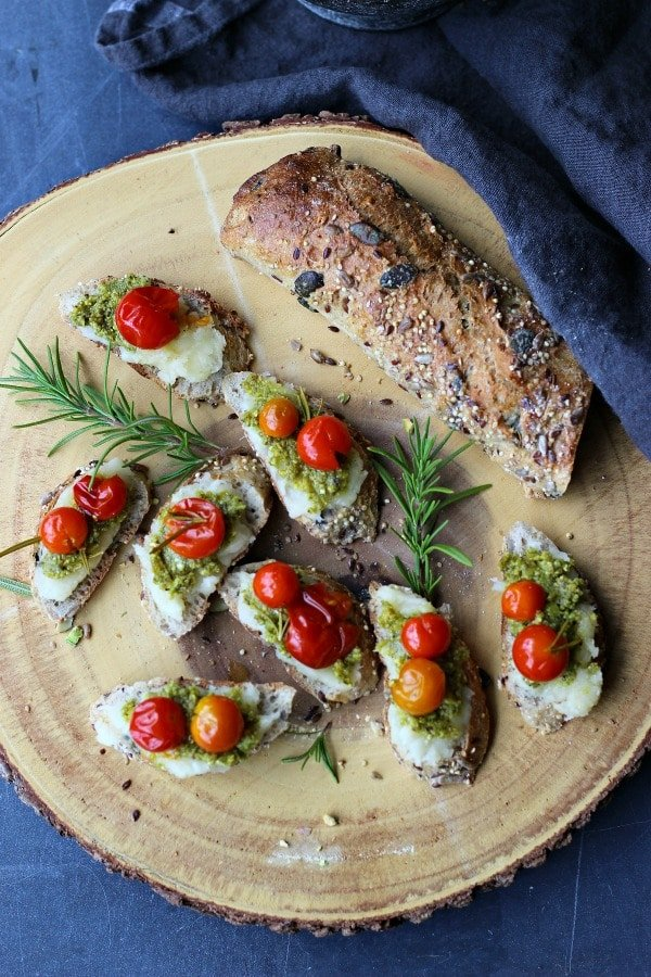 This Pistachio and Yucca Crostini with fresh roasted tomatoes is made entirely from plant based ingredients. A fabulous vegan choice to serve as an appetizer or snack. A perfect recipe for the Holidays! gardeninthekitchen.com