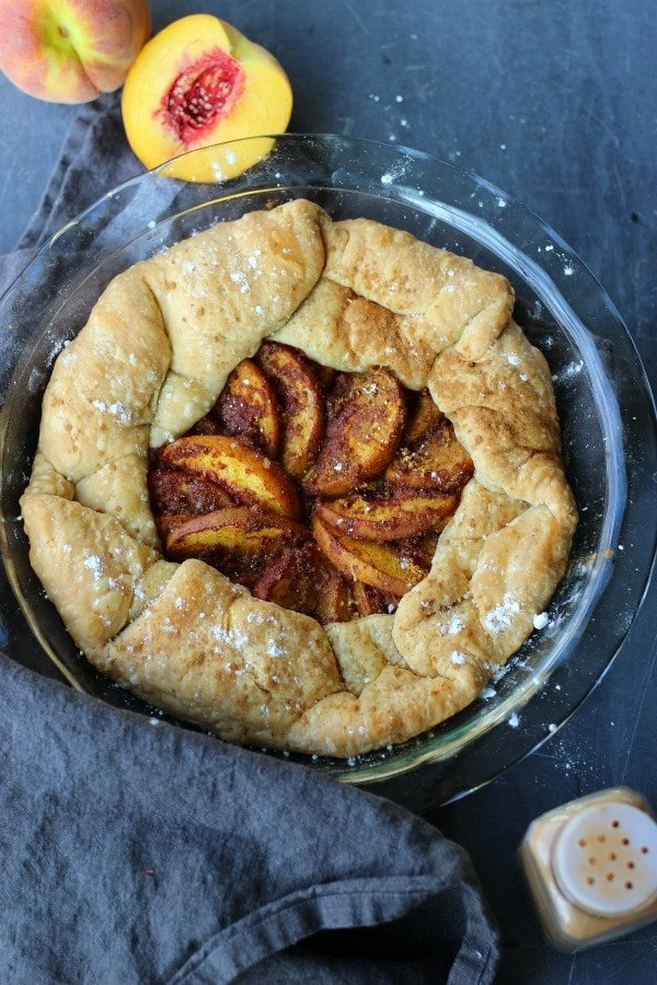 This peach galette in rustic tart baked in a buttery flaky pastry is everything you've always wanted. Few ingredients and no refined sugars, this doesn't get any better! gardeninthekitchen.com