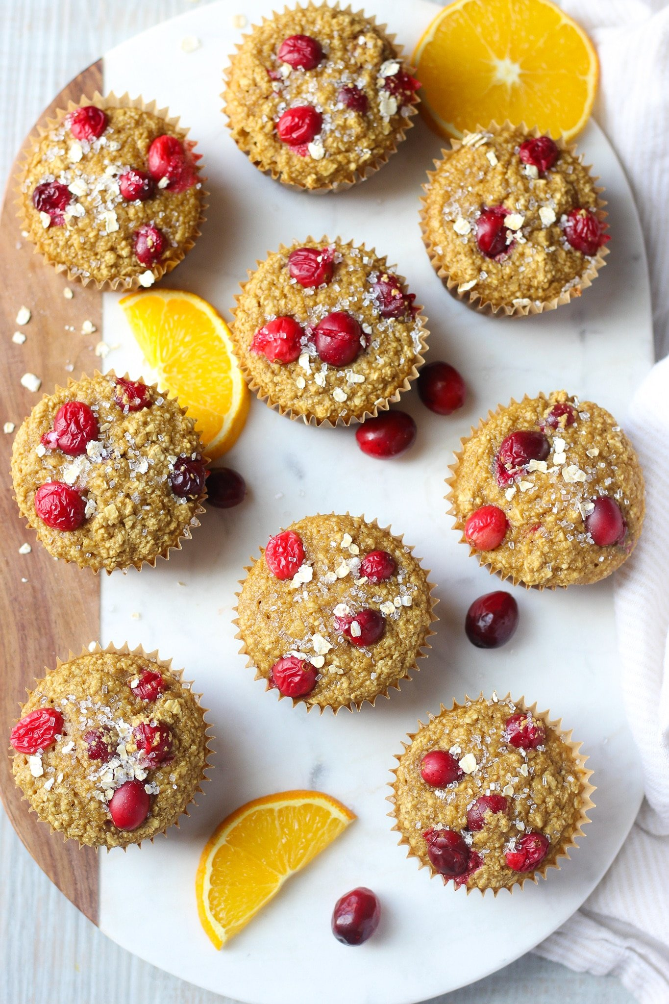 Muffins topped with fresh cranberries