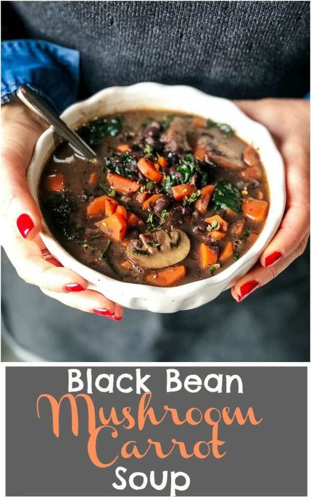 Hands holding a bowl of Black Bean Mushroom Carrot Soup