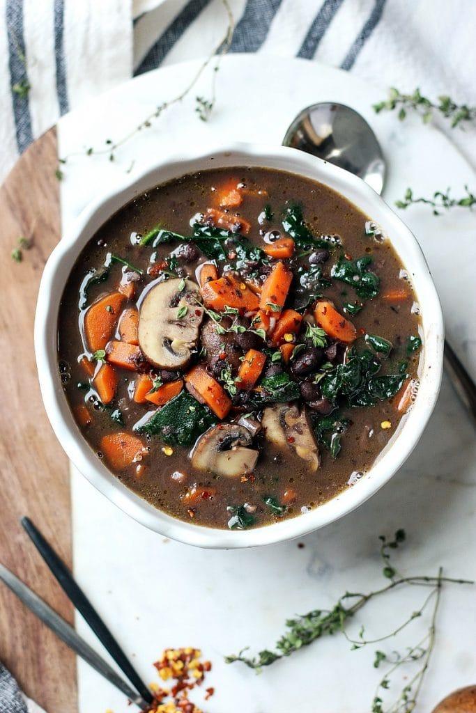 Black Bean Mushroom Carrot Soup in a white bowl