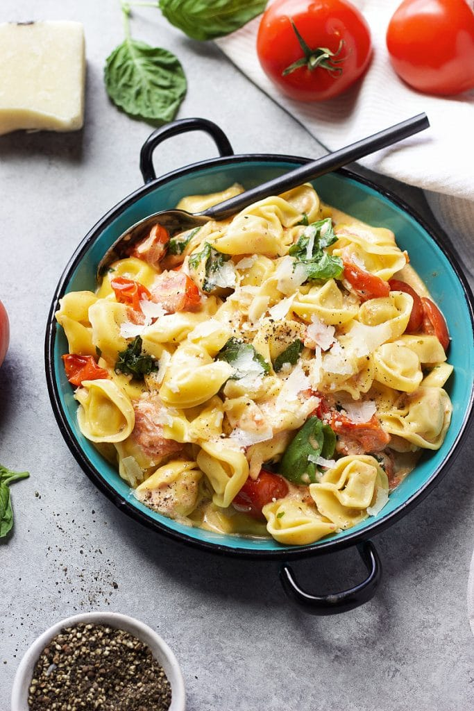 Creamy Tortellini  topped with tomatoes basil