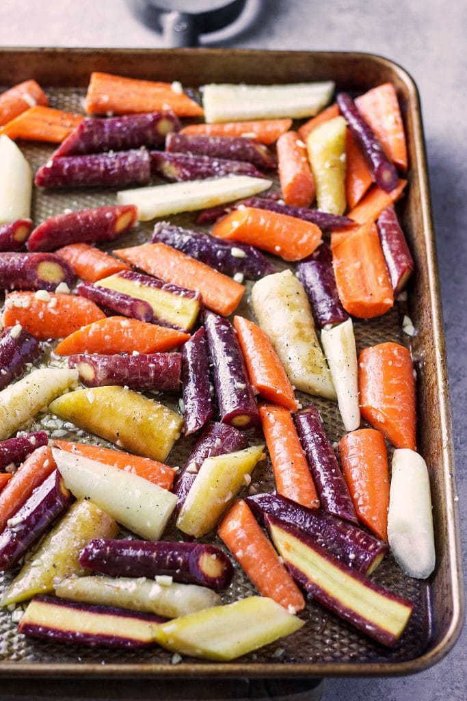 Sliced carrots in a sheet pan