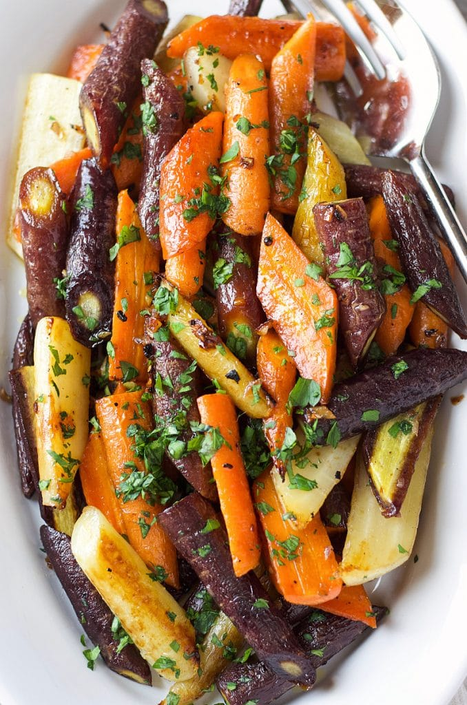 Honey Roasted Carrots in different colors topped with fresh cilantro