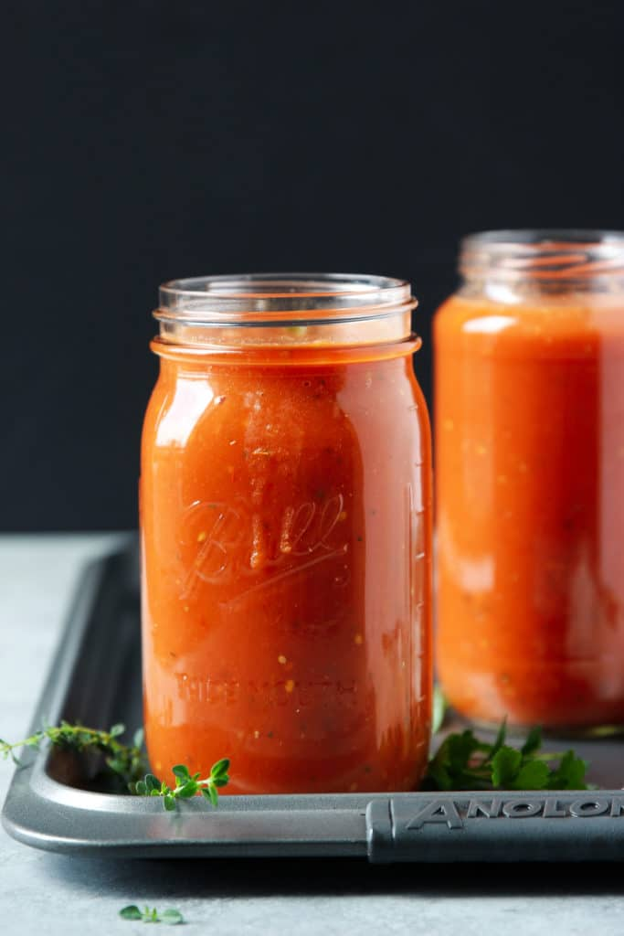 Homemade tomato sauce in two glass jars