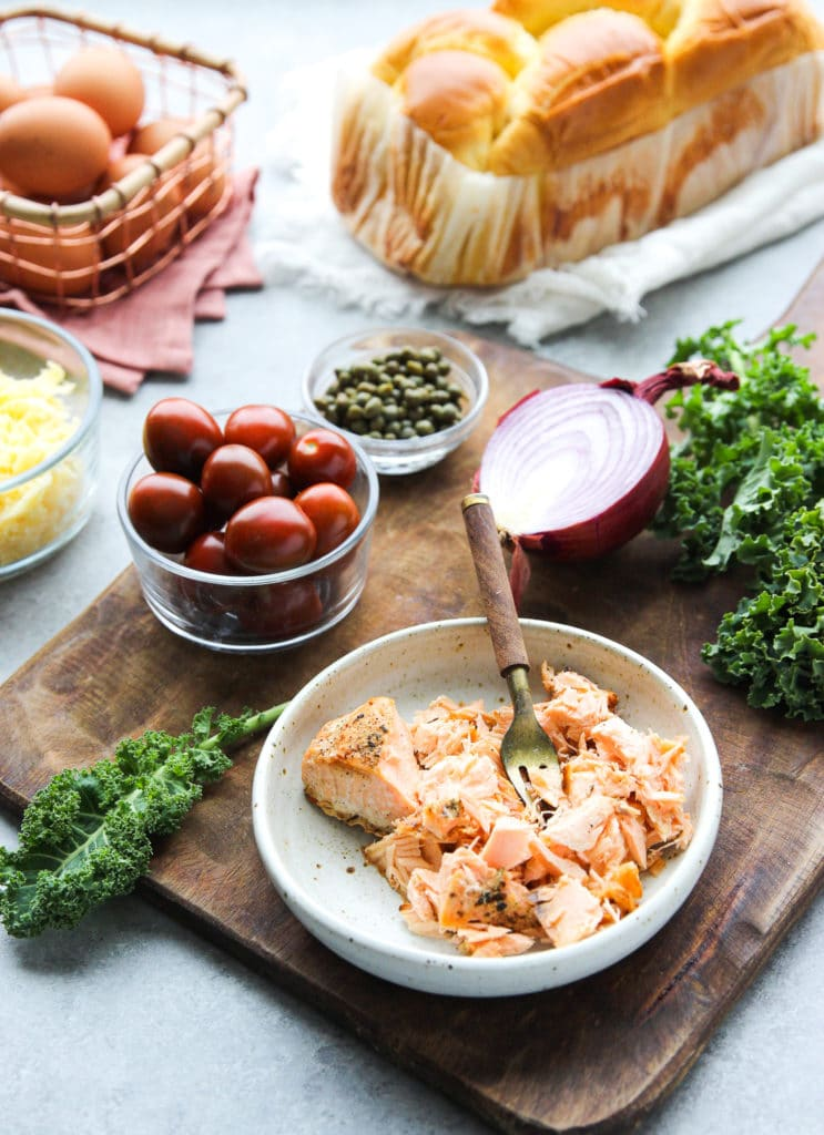 Eggs, brioche bread, shredded salmon, onion, kale and other ingredients
