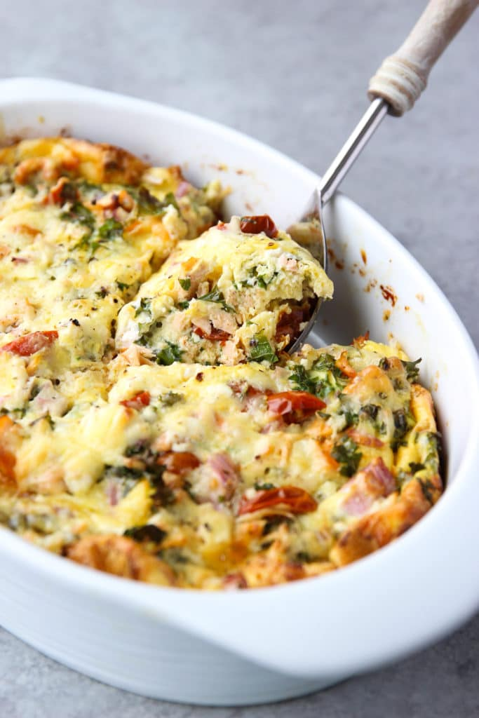 Smoked Salmon Breakfast Casserole with a serving spoon scooping a portion
