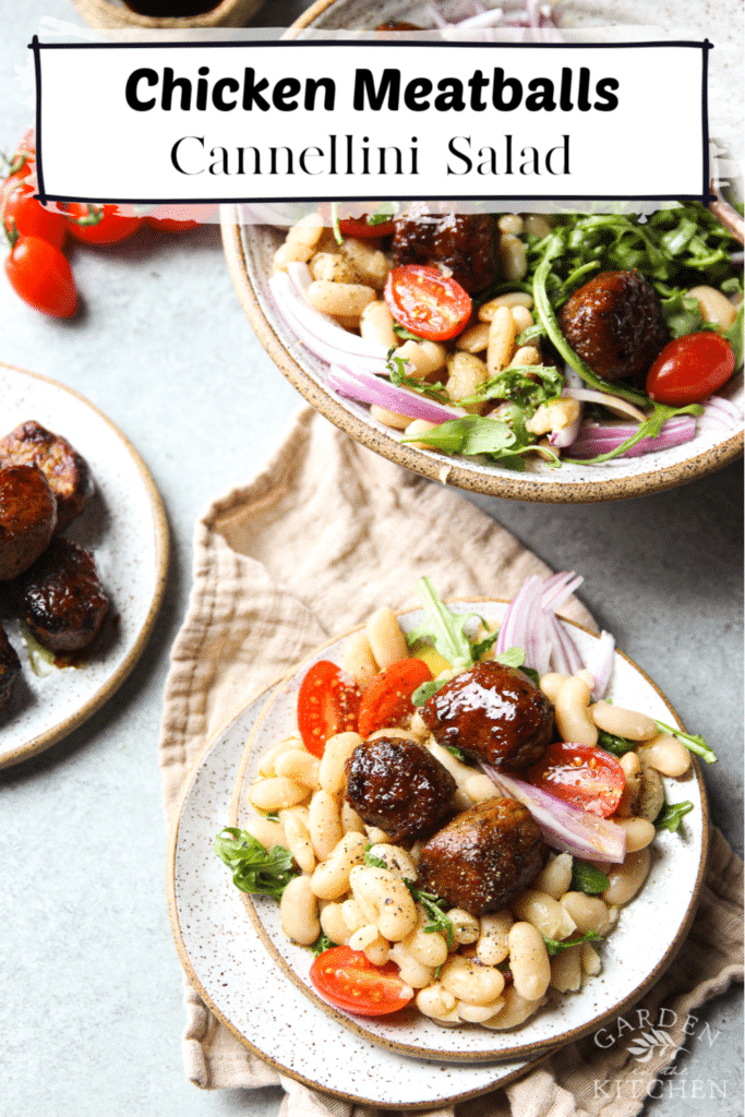 White Bean Salad topped with chicken meatballs in a shallow bowl and a small plate, a few cherry tomatoes and a small plate of chicken meatballs.