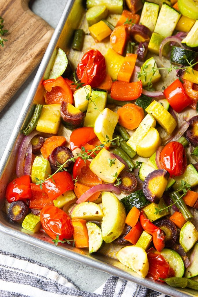 roasted vegetables in a sheet pan