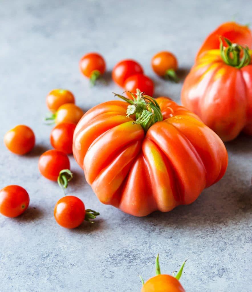 big costoluto florentino tomato with cherry tomatoes around