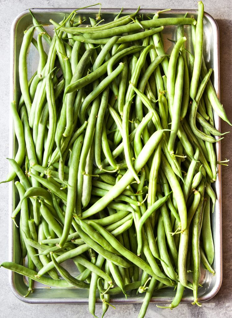 a tray of fresh green beans