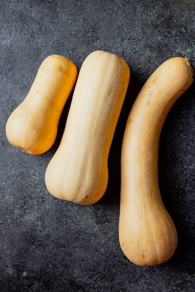 three butternut squash; small, medium and large