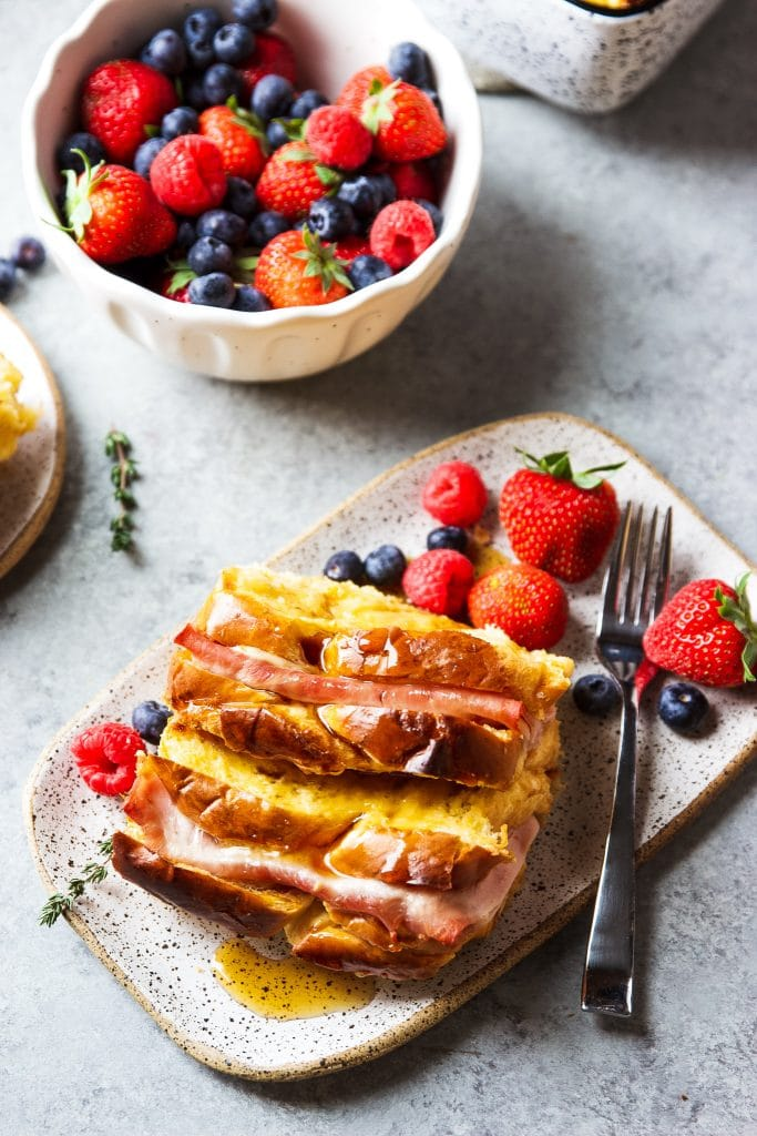 Ham and Cheese Breakfast Casserole served with warm syrup and a side of berries!