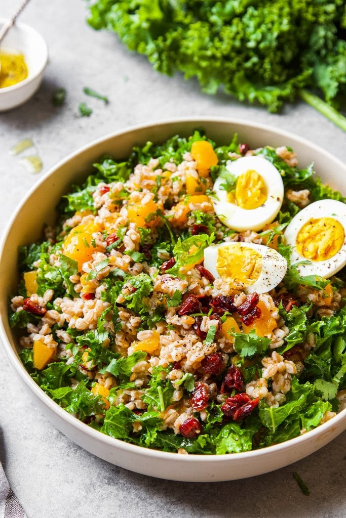 This Instant Pot Farro Bowl with butternut squash, kale, dried cranberries and hard boiled eggs.