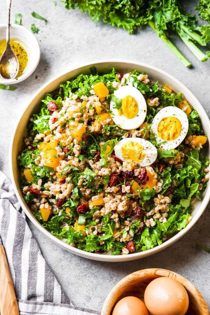 Instant Pot Farro Bowl with butternut squash, kale, dried cranberries and hard boiled eggs.