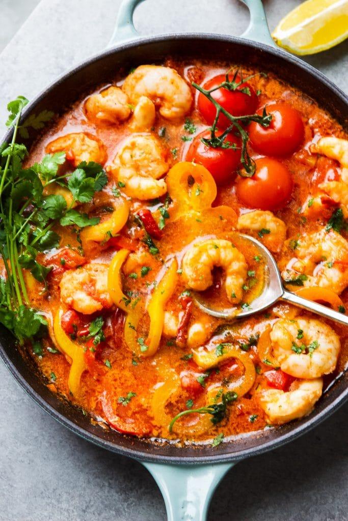 shrimp stew (moqueca de camarão) in tomato and coconut milk sauce. Fresh tomato, bell pepper and cilantro are part of this dish.