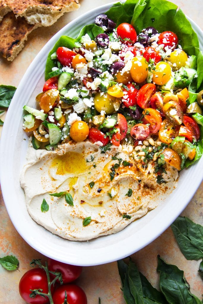 This Mediterranean Hummus Salad brings creamy hummus and vibrant fresh vegetables together to create a delightfully light summer dish.