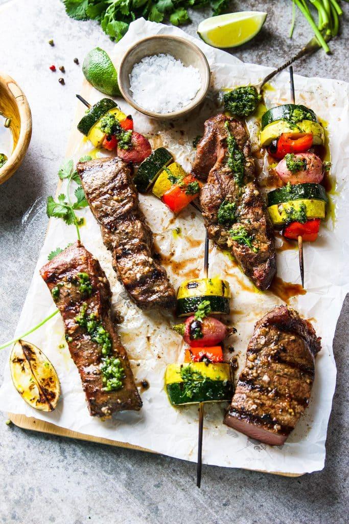 Churrasco steak with grilled veggie kebabs