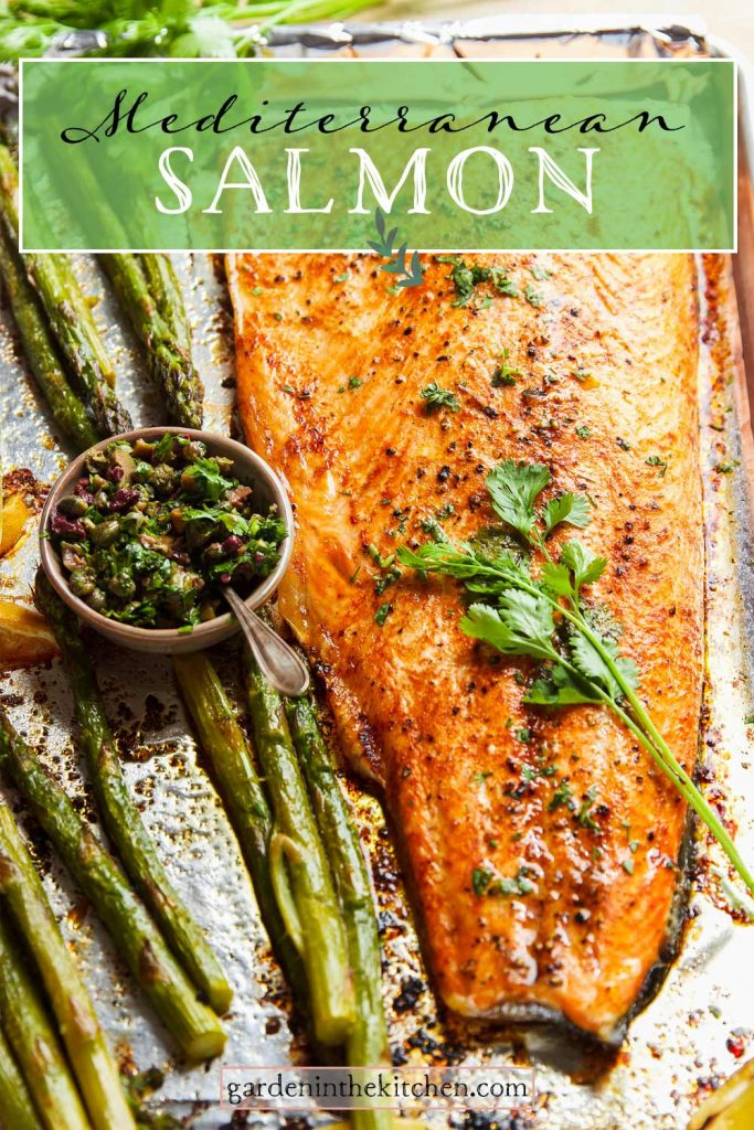 mediterranean salmon on sheet pan with asparagus, capers and olives and fresh herbs