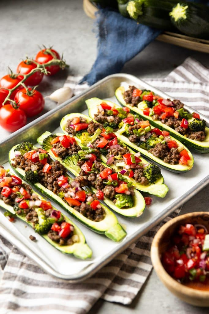 Stuffed zucchini boats with ground beef, broccoli and topped with homemade tomato salsa