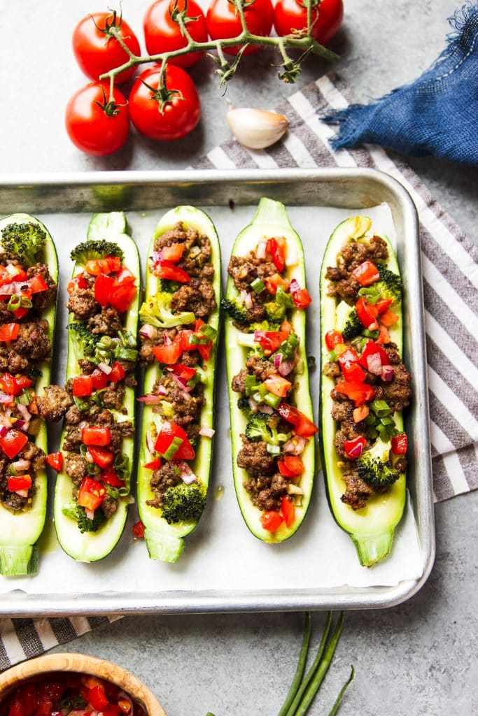 stuffed zucchini boats with ground beef, broccoli and tomato salsa
